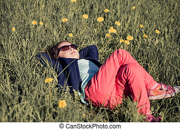 Cute relaxing kid girl in fashion clothers and sunglasses...