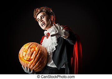vampire with pumpkin - Portrait of a handsome vampire with...