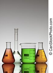 laboratory beakers - group of four flasks containing colored...
