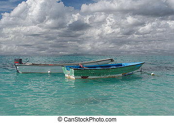 caribbean sea and boats - a view of two boats in caribbean...