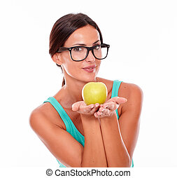 Smiling brunette woman holding an apple