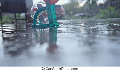 Toy water mill in the rain - Bright toy water mill in motion...