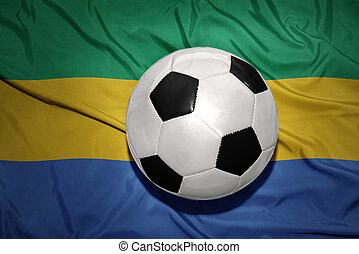 black and white football ball on the national flag of gabon...