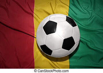 black and white football ball on the national flag of guinea...