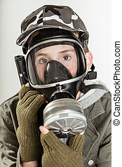 Child holding gas mask over face - Close up of single male...