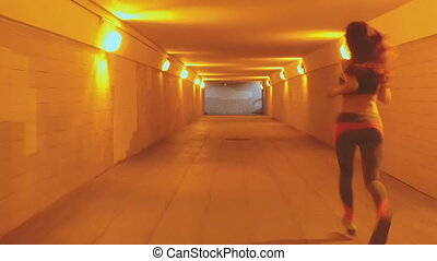 Girl running in sports underpass
