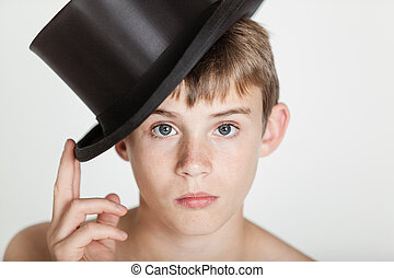 Serious child tipping his hat on head - Single bare...