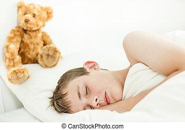Adorable boy sleeping with plush bear - Single adorable boy...