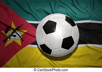 black and white football ball on the national flag of...
