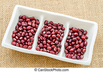 Azuki red beans in white cup. - Azuki red beans in white cup...