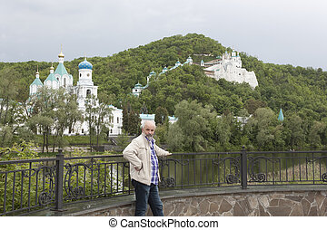 Church Svyatogorsk Lavra Cloudy day in May The man on the...