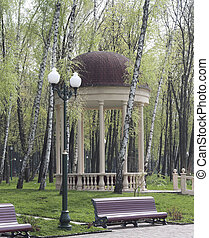 Arbour among the birch trees, benches and lanterns in the...