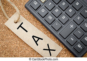 The word tax written in recycle tag with calculator on...