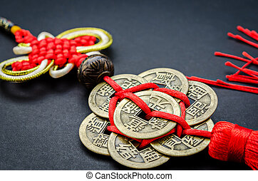 Antique Chinese coins on black background - Antique Chinese...