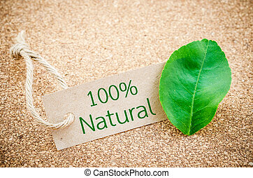 100 Natural word on recycle brown tag with green leaf - 100...