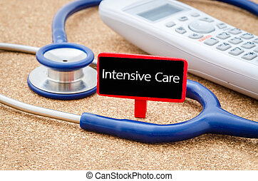 Intensive care words - Phone and stethoscope on the table...