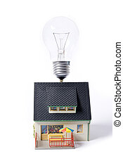 house with bulb - house with flash bulb on roff