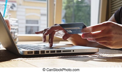 Woman with credit card and laptop - Woman makes purchases...