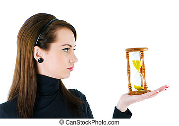 Woman with hourglass isolated on the white