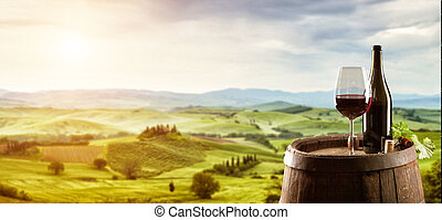Red wine with barrel on vineyard in Italy - Red wine with...