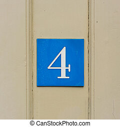 Number 4 - house number four, engraved in a plastic plate