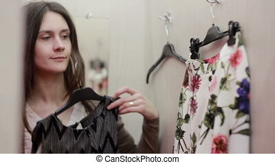 Beautiful girl trying clothes in a fitting room - Beautiful...
