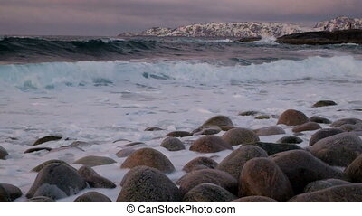 Big storm in the Arctic Ocean. The waves beat against the...