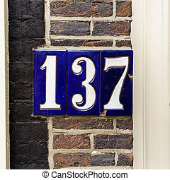 number 137 - Ceramic house number one hundred and thirty...