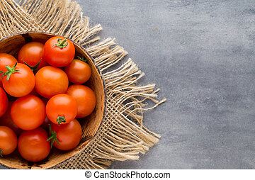 Tomato on the gray background.