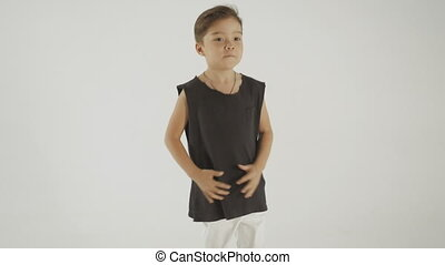Little Stylish Boy In Black T-Shirt Dancing And Having Fun,...