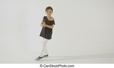 Stylish Little Boy In Black T-Shirt Dancing And Having Fun,...