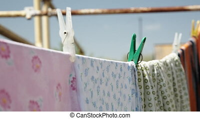 Clothes drying in the fresh air - Colorful clothes drying in...