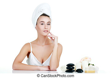 Beauty Portrait. Beautiful Spa Woman Touching her Face. Perfect