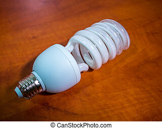 broken bulb light over brown background, shadow