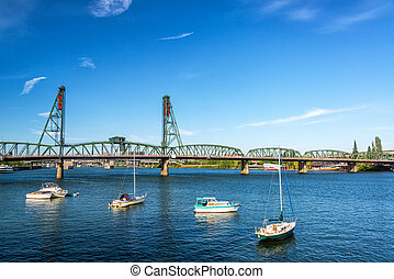Hawthorne Bridge and Boats - Four boats in front of the...