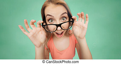 happy young woman or teenage girl in eyeglasses - vision,...