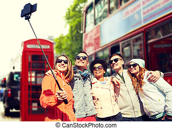 friends taking selfie with smartphone in london - tourism,...