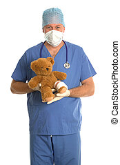 Surgeon with teddy bear - Surgeon in scrubs holding a teddy...