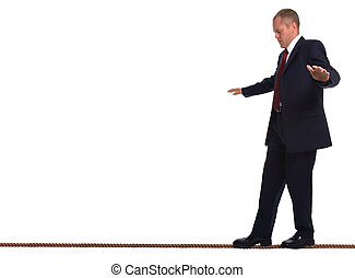 Businessman walking a tightrope - Businessman walking along...