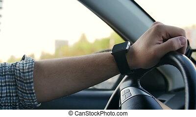 Man hands using smartwatch touchscreen portable technology...