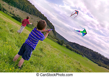 Two boys with kites - Two young boys flying their kites in a...