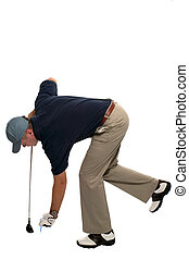 Golfer teeing up - Golfer bending over to insert a tee and...