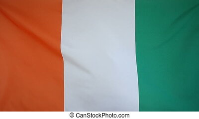 Slowmotion textile Flag Ivory Coast - Slowmotion of a real...