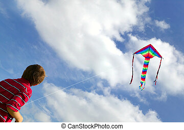 Boy flying a kite. - Young boy flying his kite on a bright...