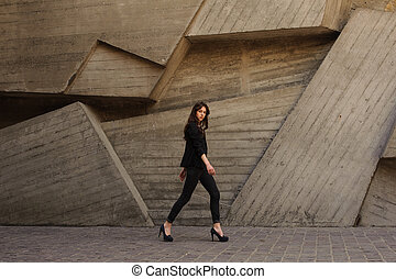 young business woman walking outdoors on hills