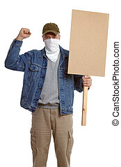 Masked protester with clenched fist, holding a blank placard...