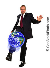 Businessman kicking globe - Businessman kicking the world...