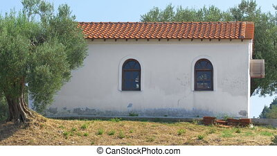 Small House In The Trees - Traditional small house between...