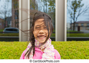 Wind blowing asian girl's hair - Side wind blowing happy and...