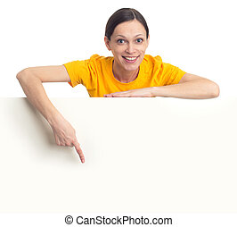 young woman pointing finger at blank poster